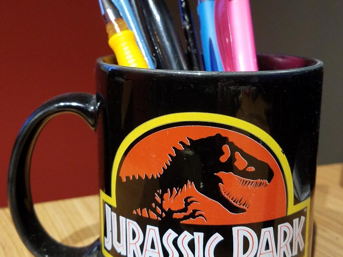 A mug full of pens and writing supplies.